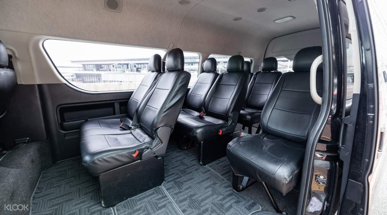 several black seats with ample legspace