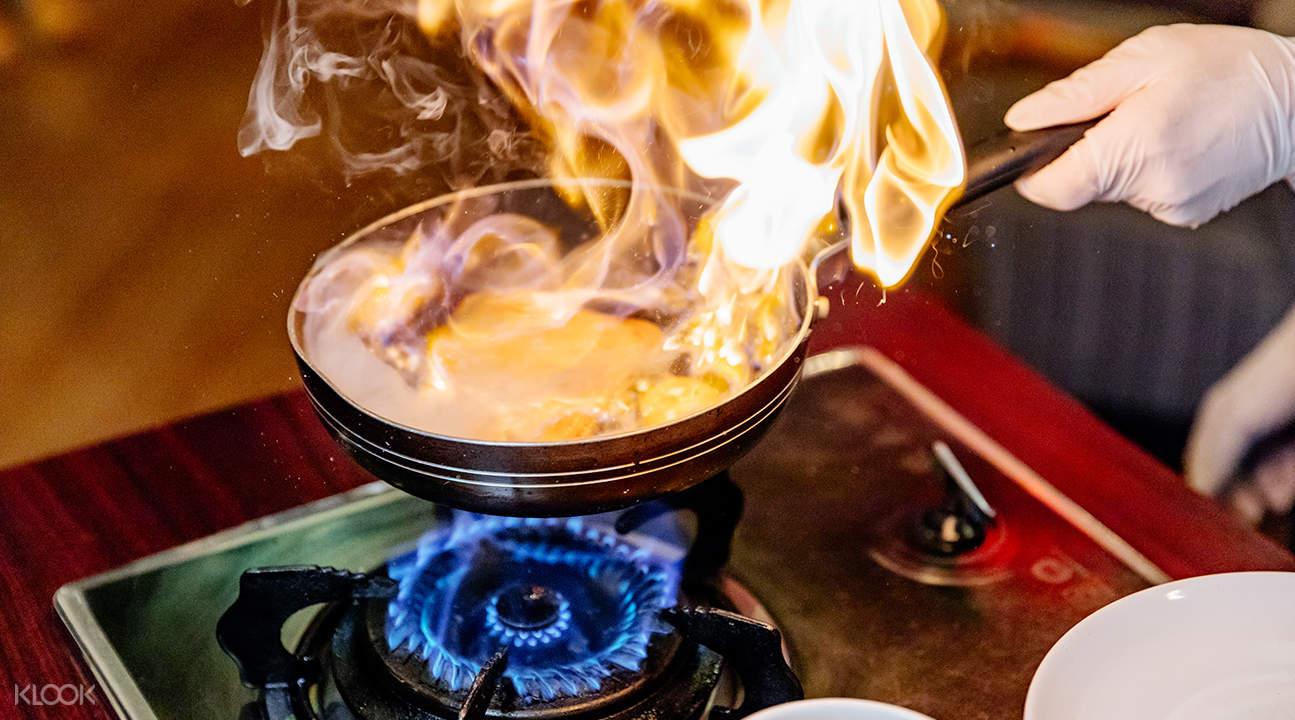 chef cooking pancakes at stella palace restaurant baiyoke sky hotel bangkok