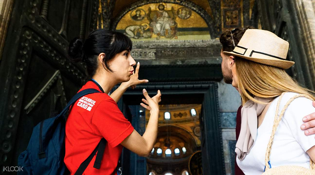 people with tour guide in hagia sophia
