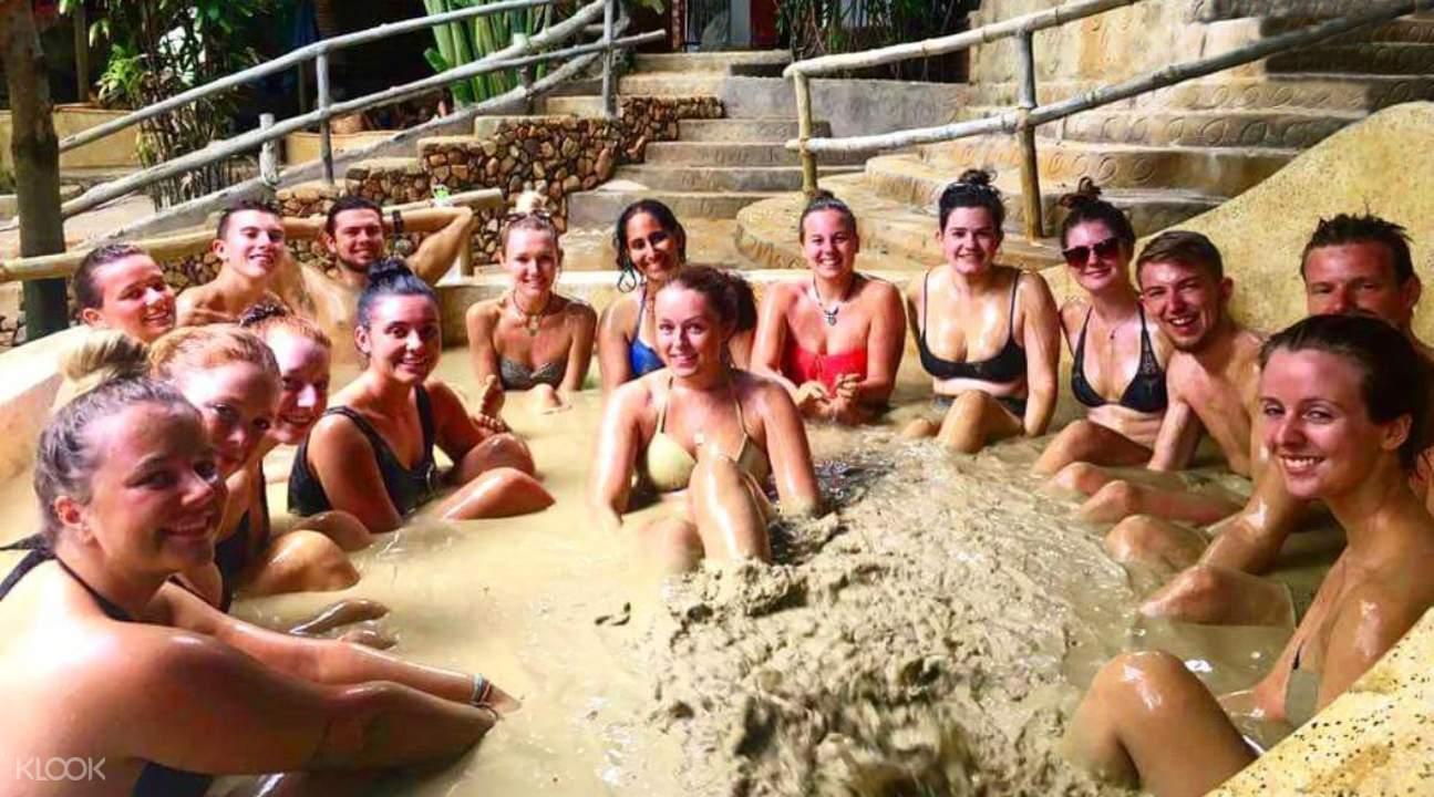 friends sharing mud bath