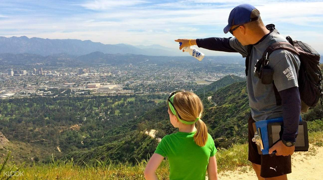 tour guide and a little girl looking at the Los Angeles skyline from the hills