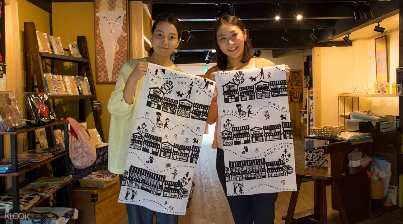 two women carrying the Japanese cotton towels they made