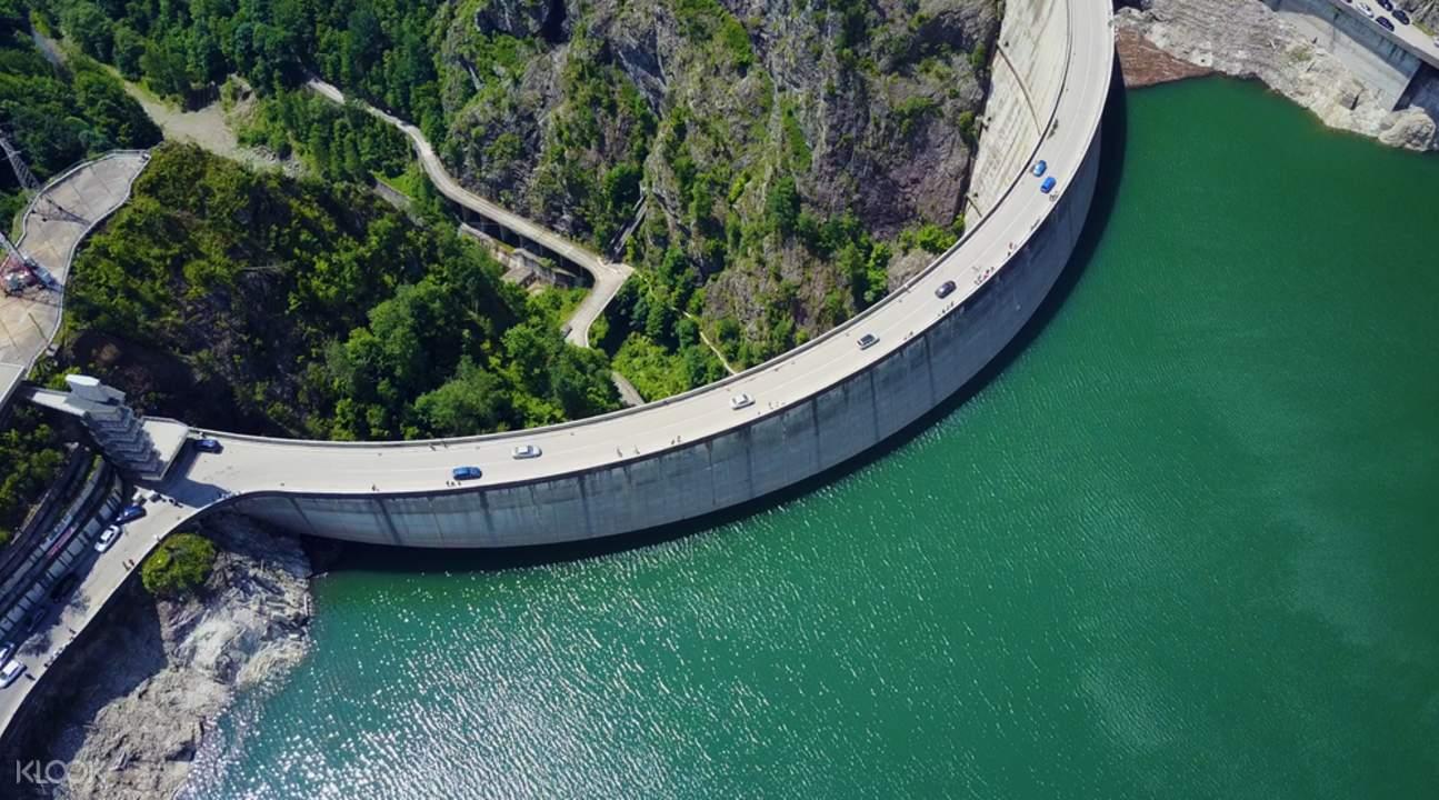 view of vidaru dam on transfagarasan road trip tour