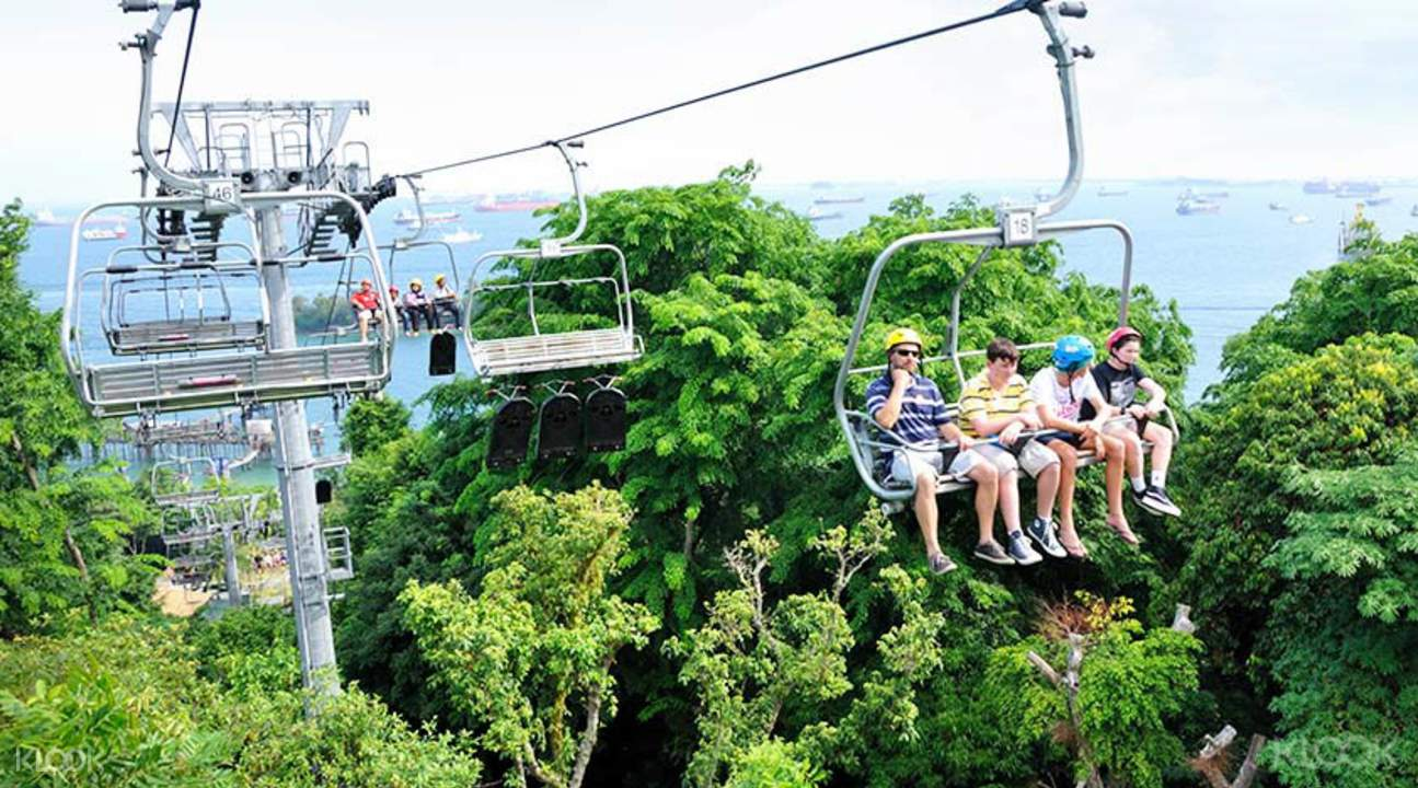 tourists riding the sentosa skyride