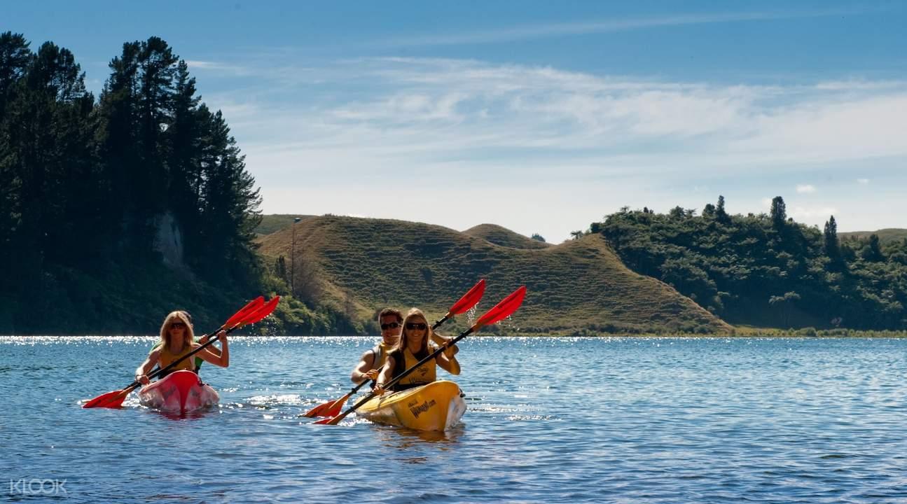 people on kayaks sailing on lake rotoiti