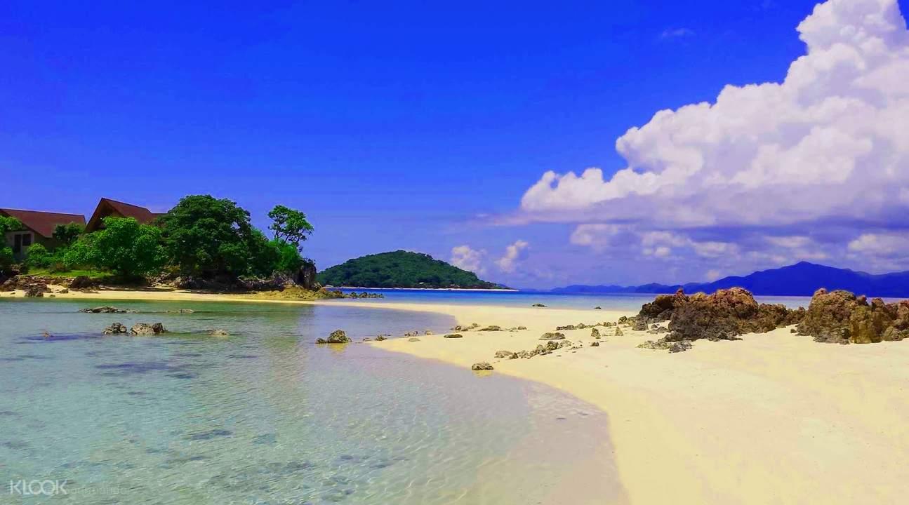 water, sand, and trees on bulog dos island