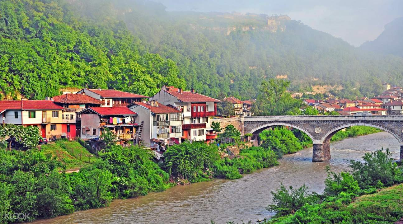 panoramic views of a village by the river