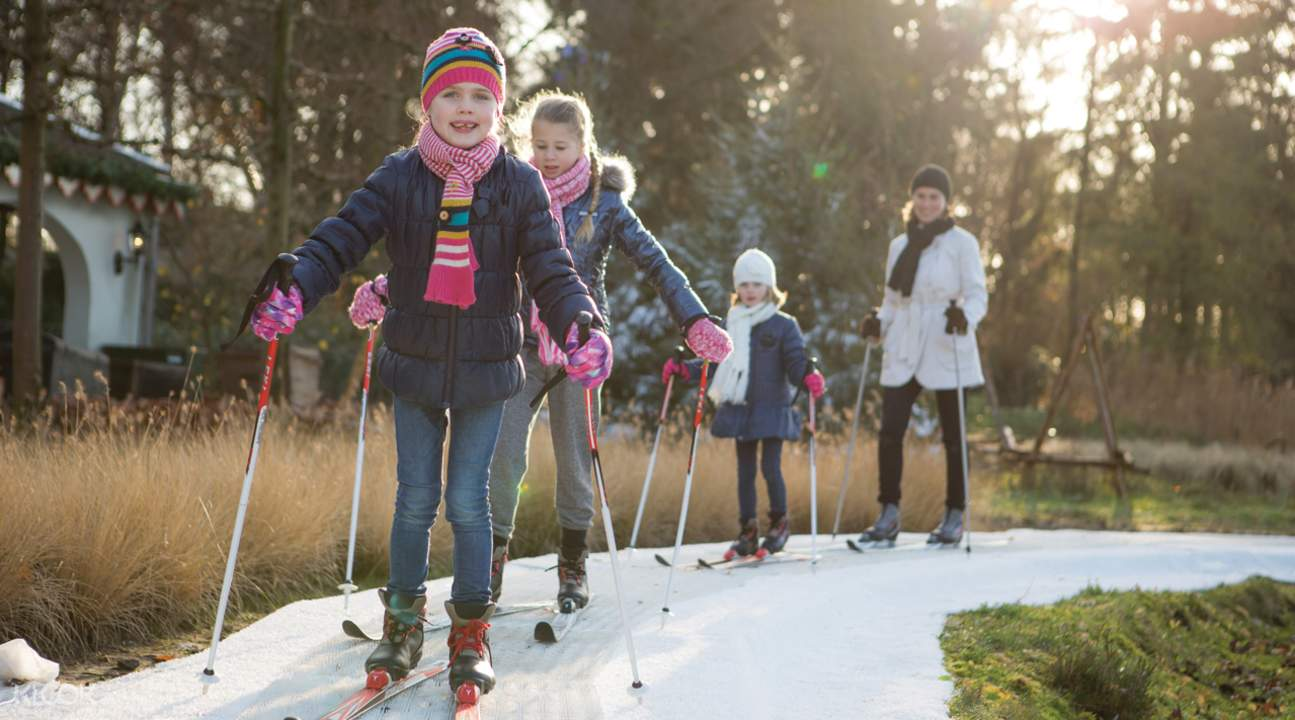 kids skiing on snow