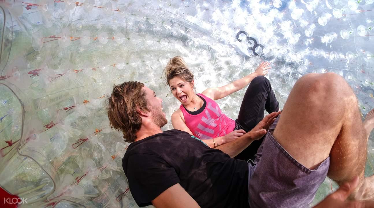 a couple inside the DRYGO inflatable ball