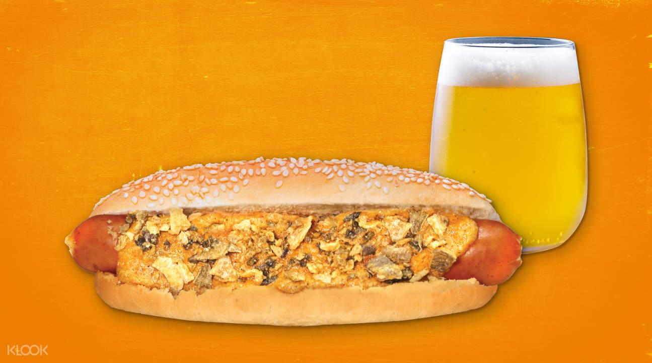 Golden Crispy Hotdog with Orange Juice at hmv Dog Bar
