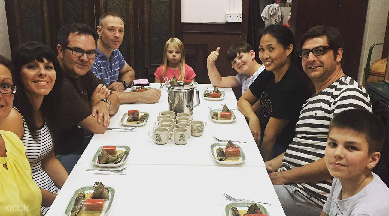 Tourists trying Kueh Lapis at Katong Food Tour