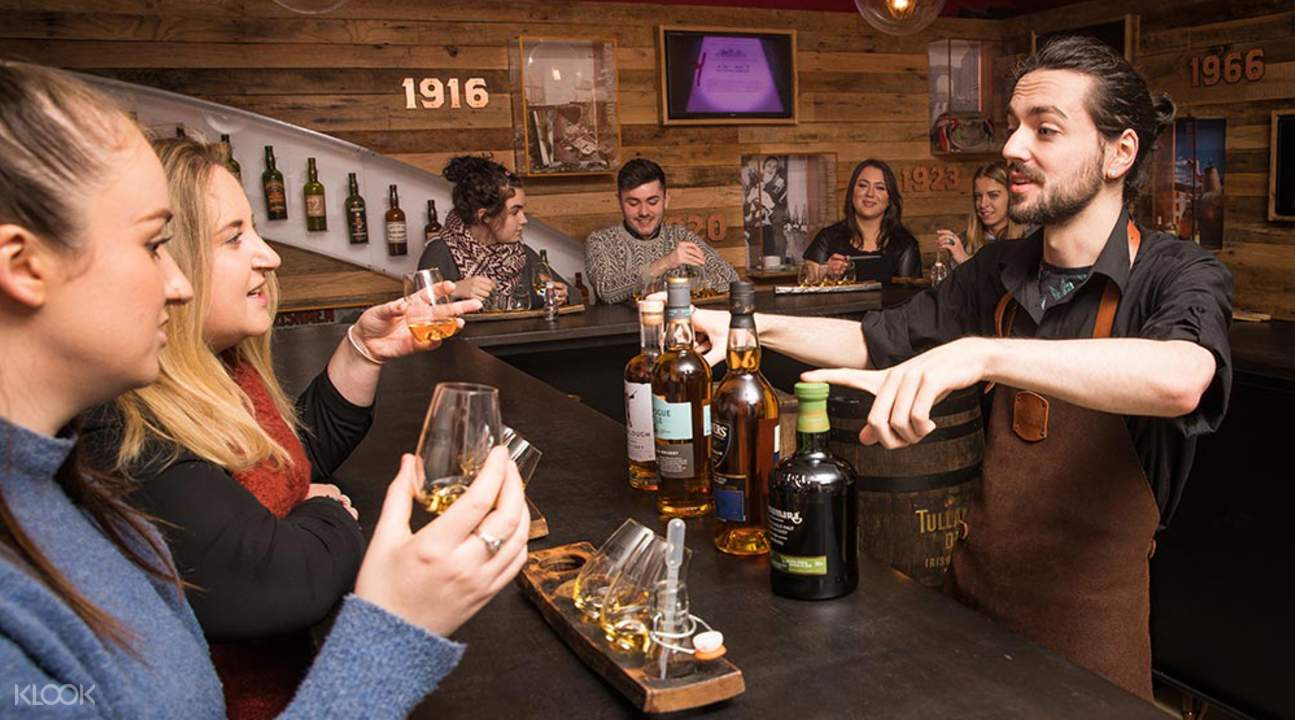 people inside irish whiskey museum