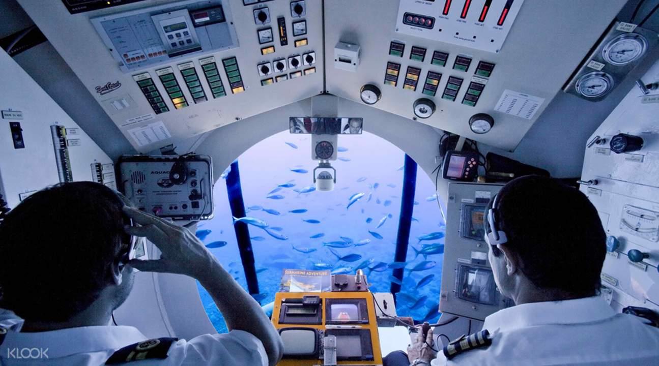 submarine captain navigating through ocean waters