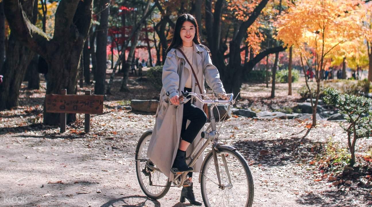girl riding a bike in nami island