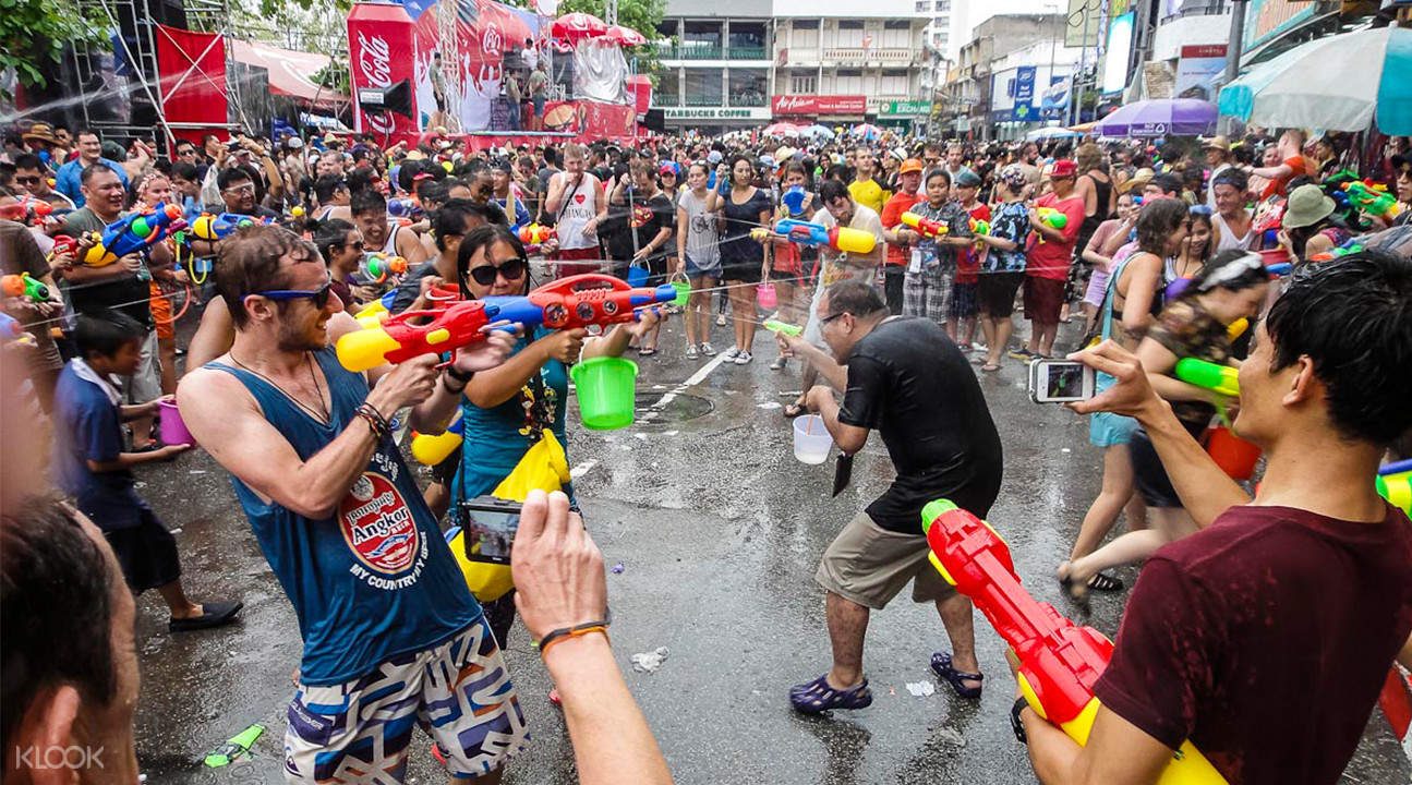 tourists and locals in a waterfight during Songkran festival