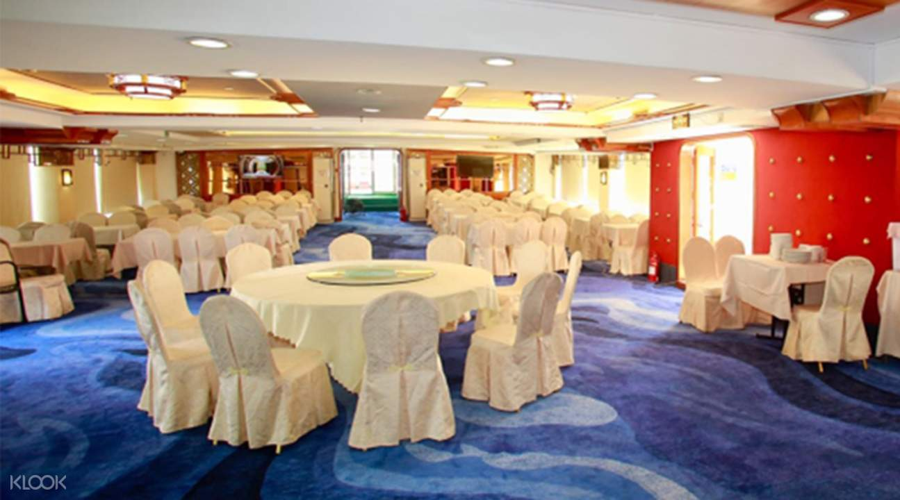 chairs and tables for dining in ferry boat for sightseeing cruise in macau