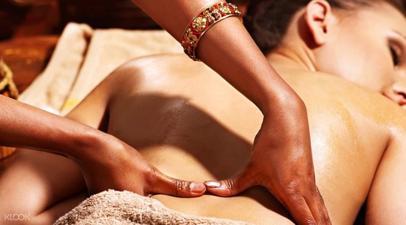 traditional ayurvedic massage on lower back