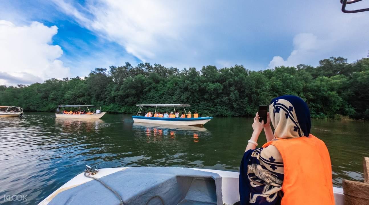 woman on boat cruise near kawa kawa village