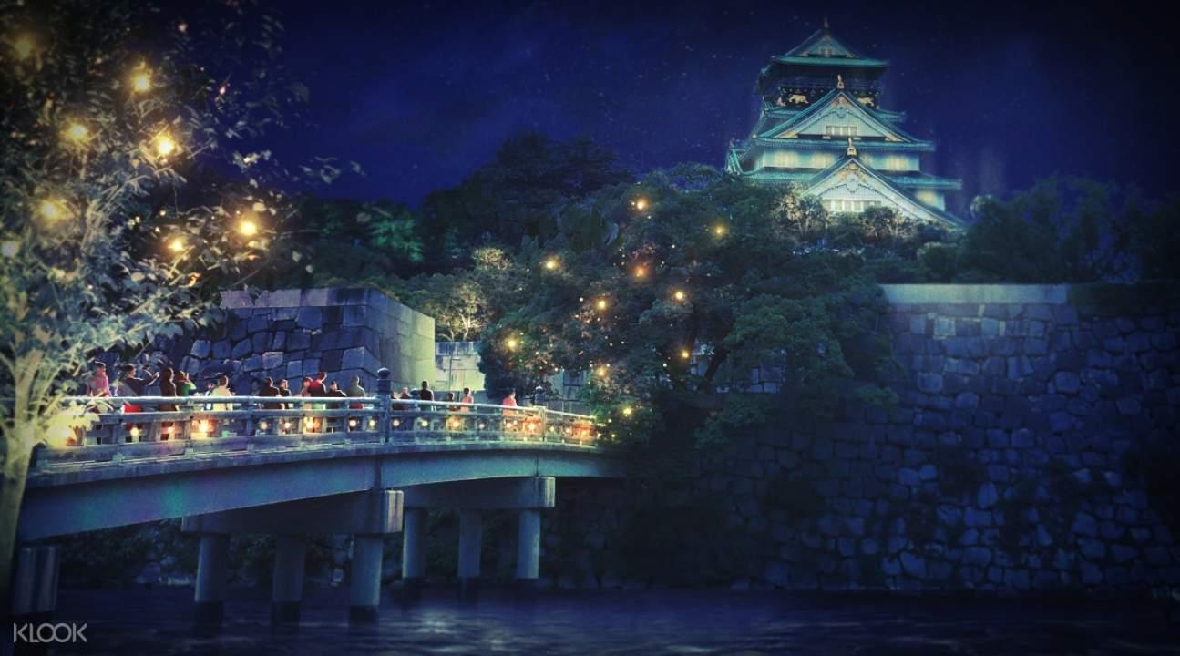bridge leading into Osaka Castle; it's nighttime