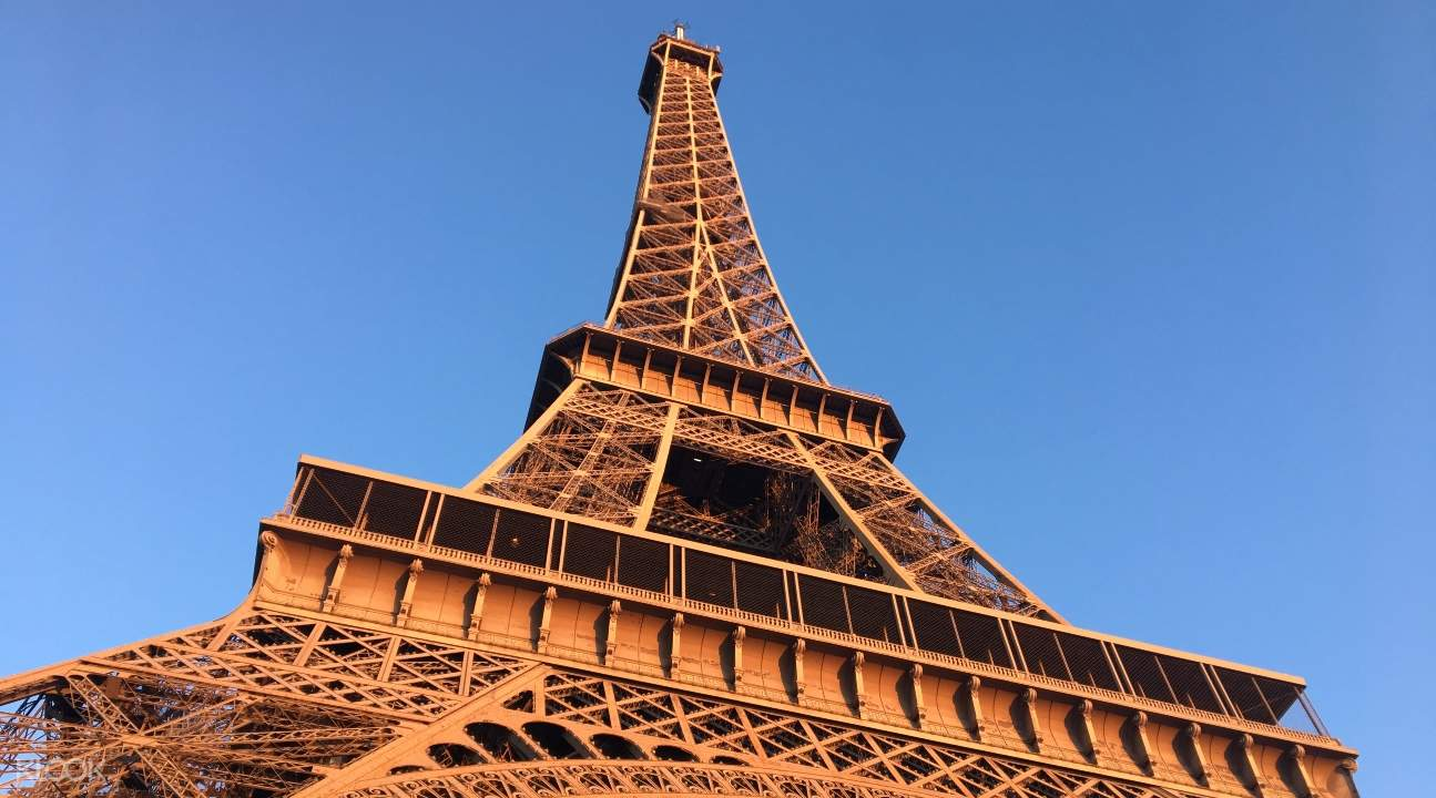 a close-up of the Eiffel Tower from below
