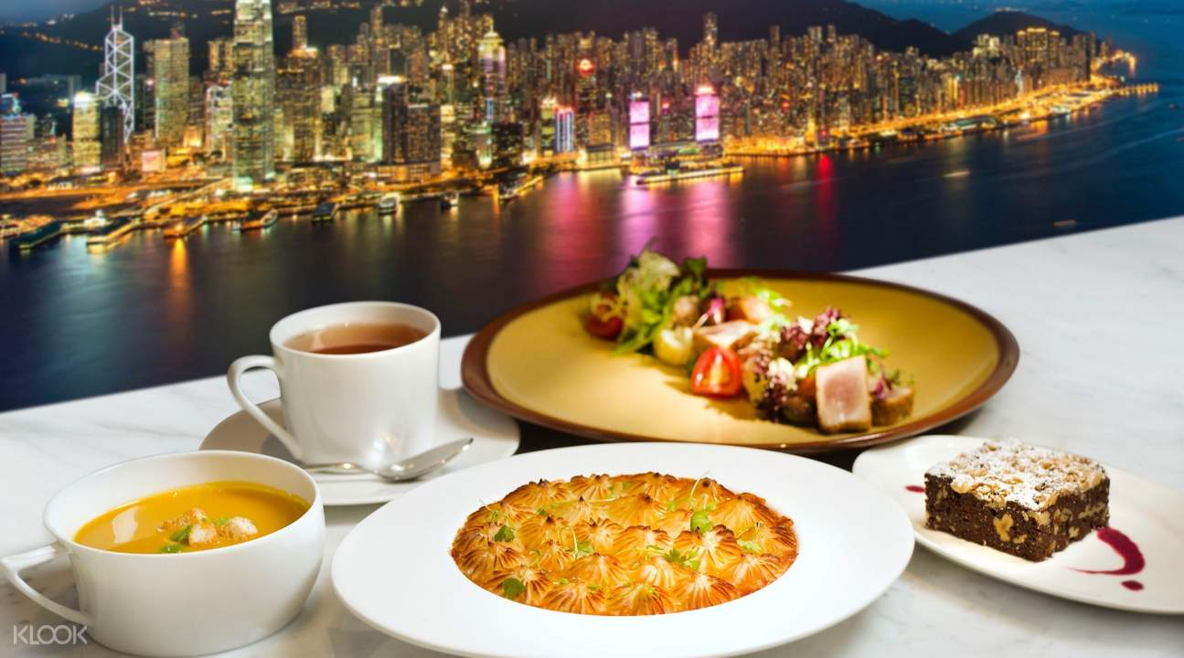 delicious food at Cafe 100 with hong kong skyline at the background