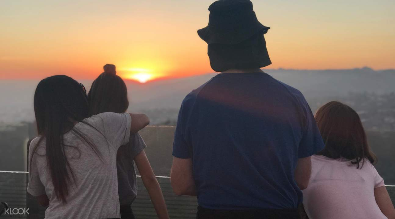 people checking out the Los Angeles skyline at dusk