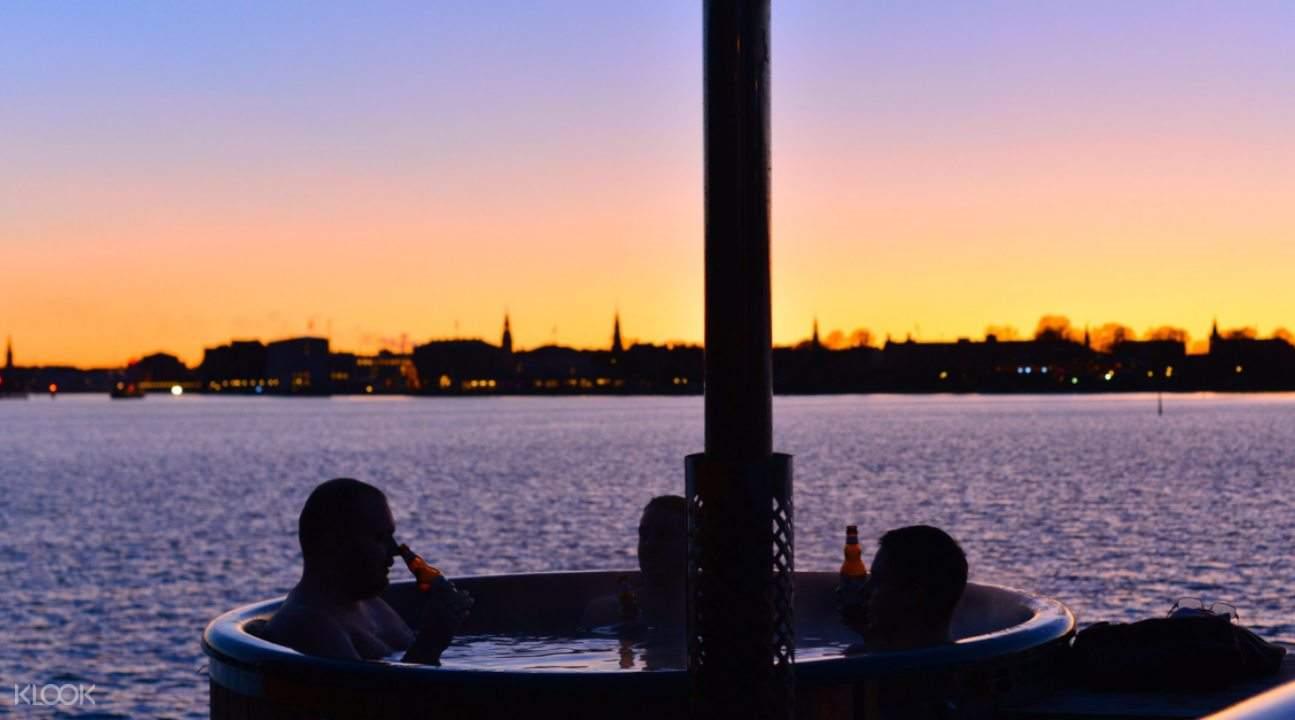 People in tub in CopenHot, Copenhagen during sunset