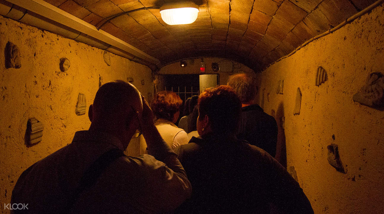 a dimly lit hall in the Roman Catacombs