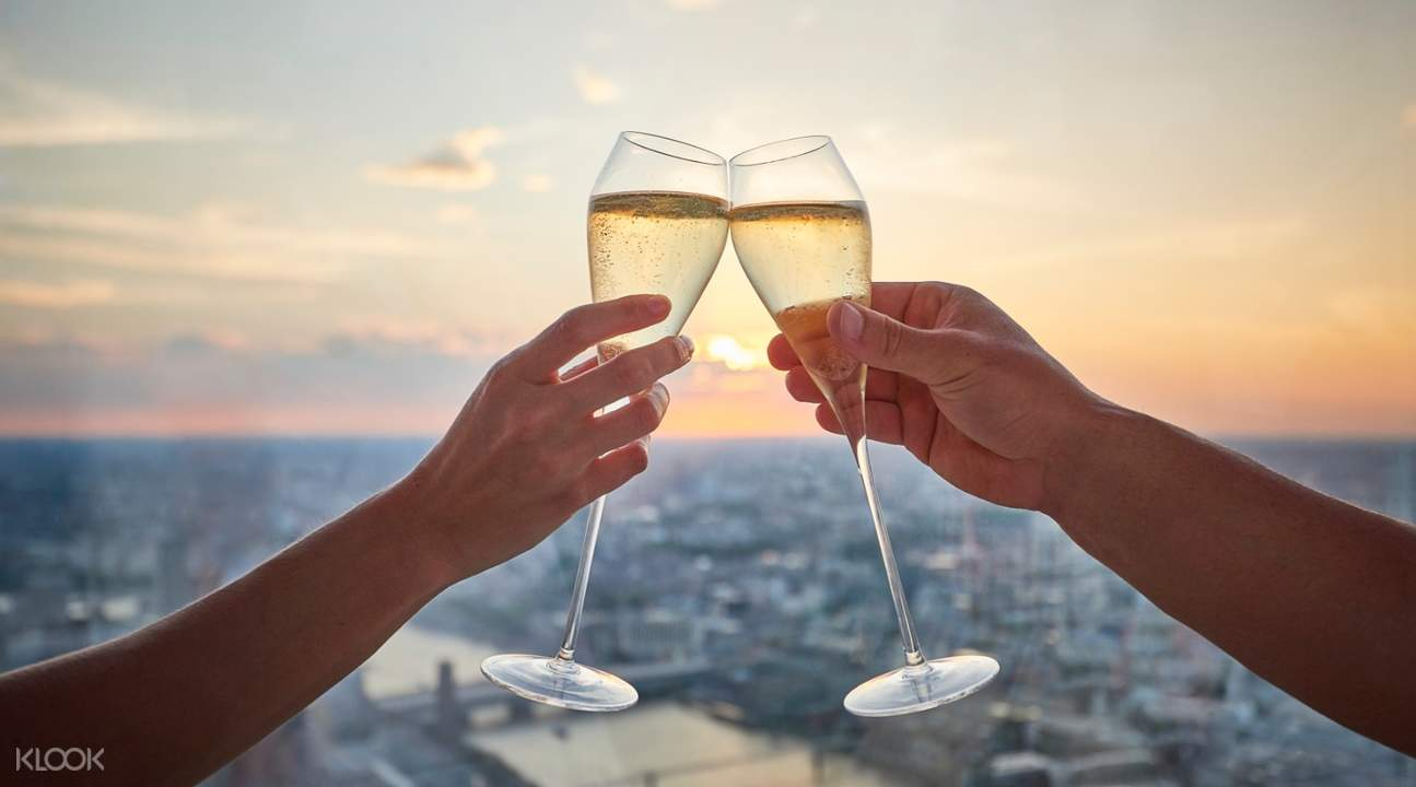 champagne glasses toasting in view from the shard