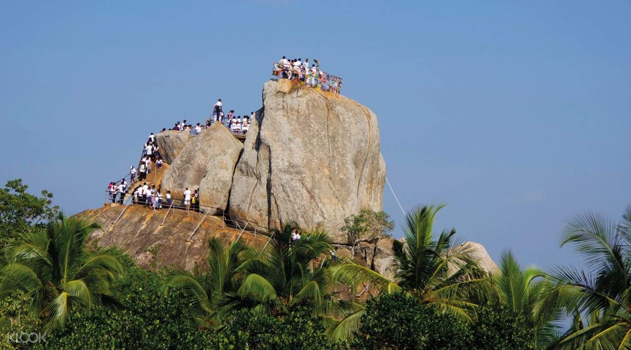 people on top of monument in anuradhapura