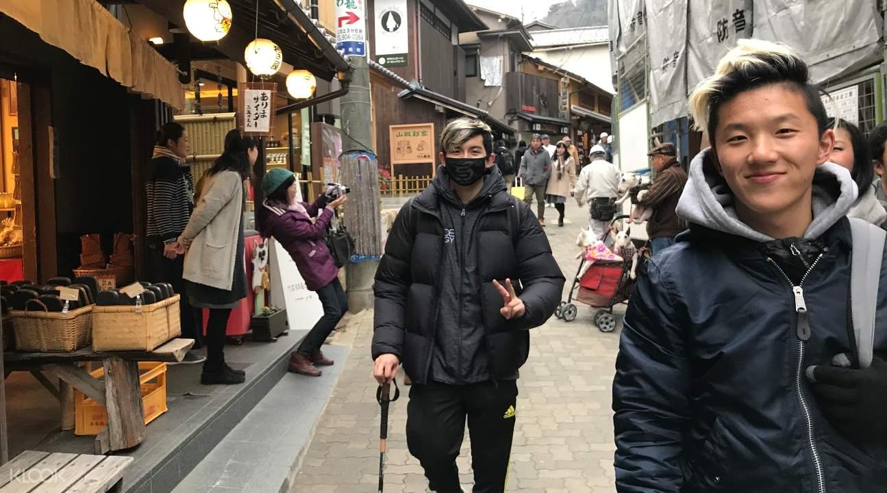 people strolling along Arima