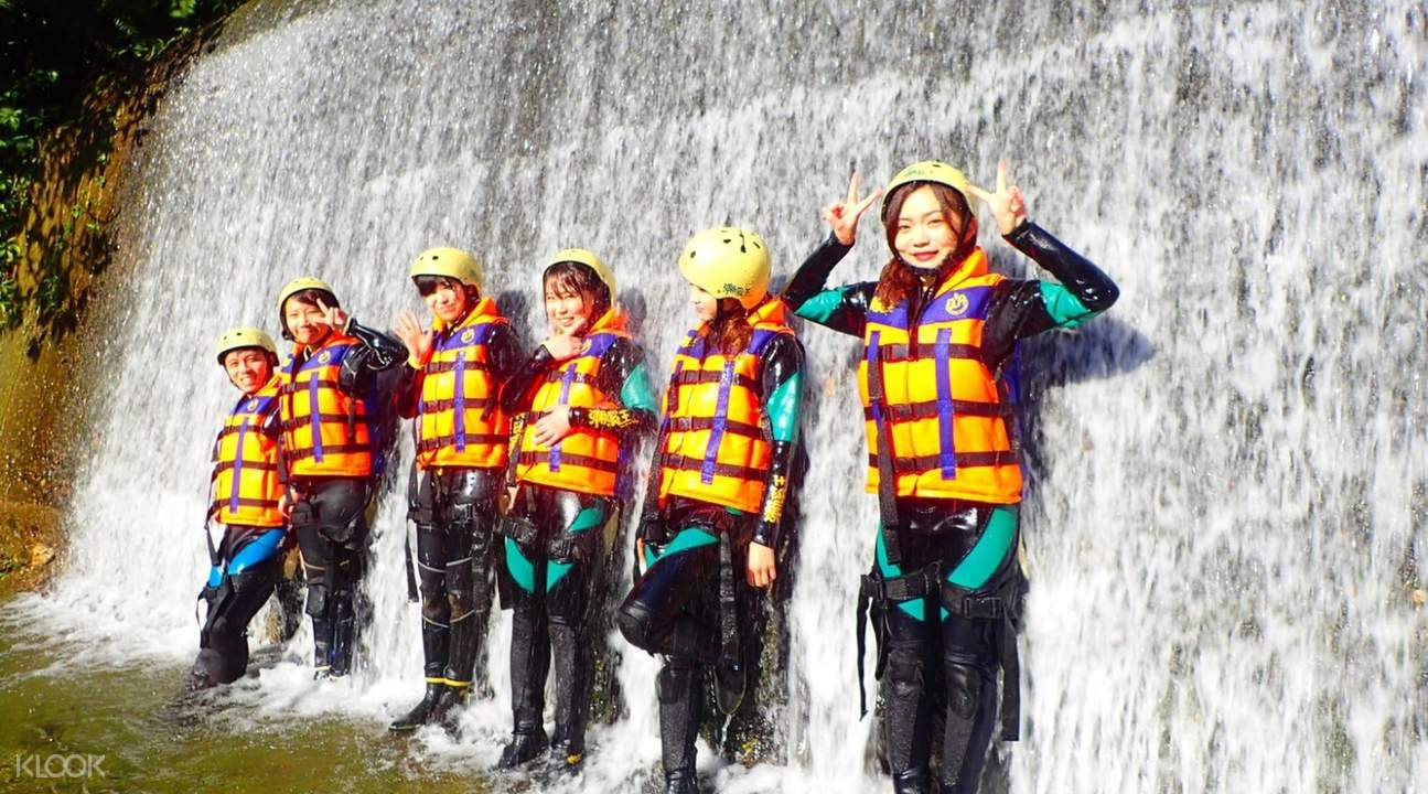 people under waterfalls during the river tracing in hualien