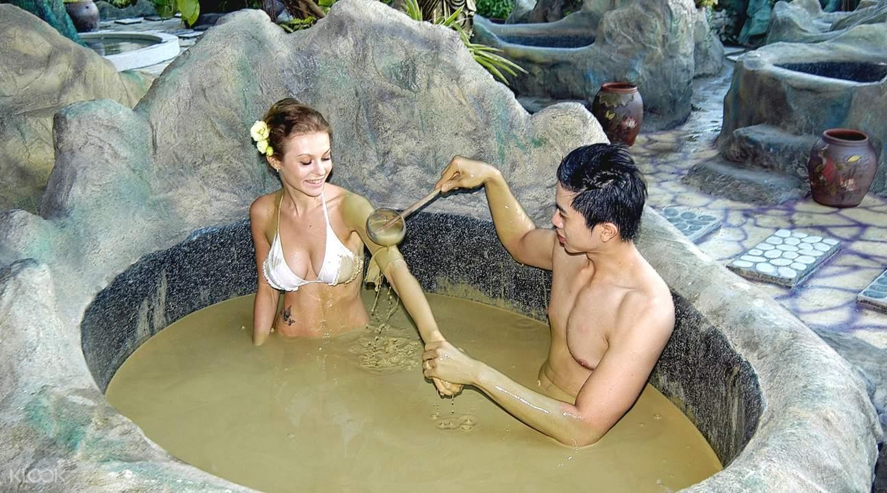 woman inside mud bath at Galina Hotel and Spa