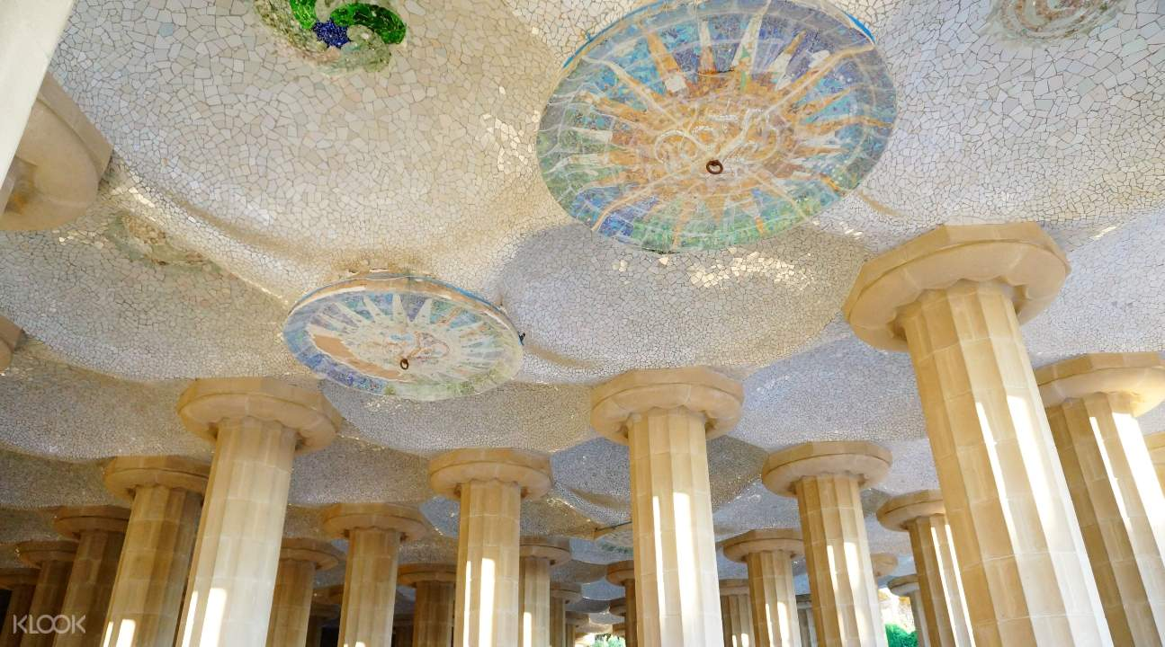 mosaics in the ceiling of a building inside Park Güell