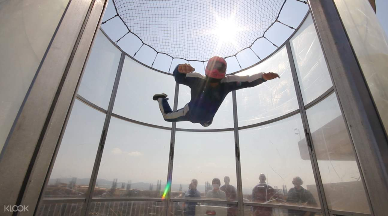 person floating inside wind tunnel Lihpao Racing park