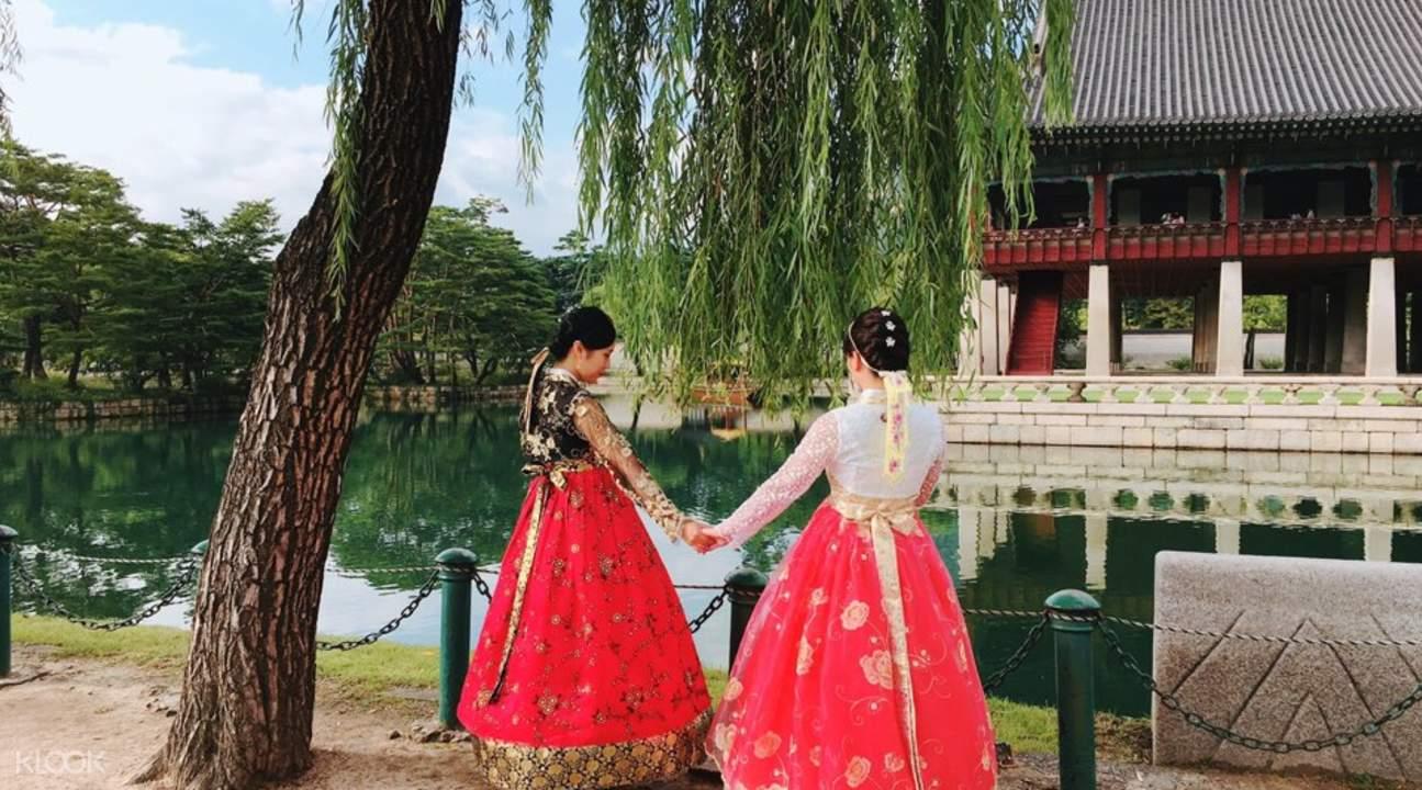 girls wearing hanboks in palace