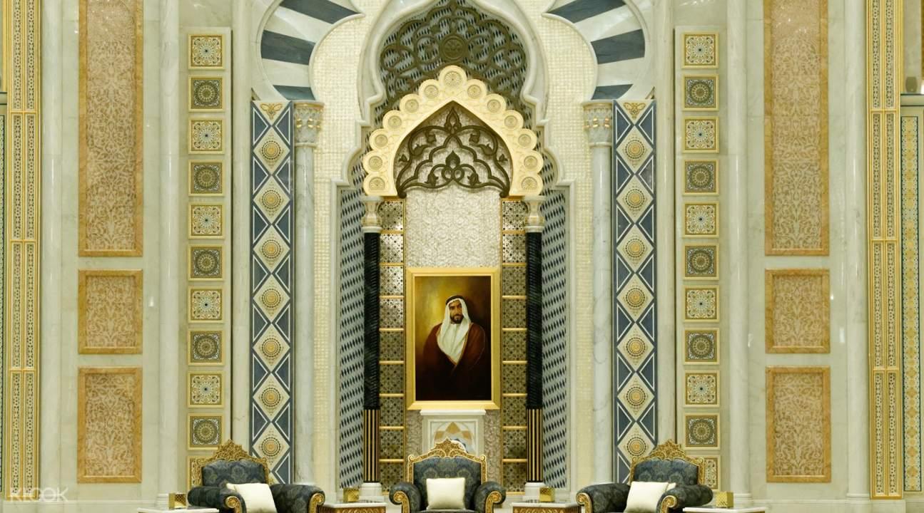 chairs and portrait in qasr al watan