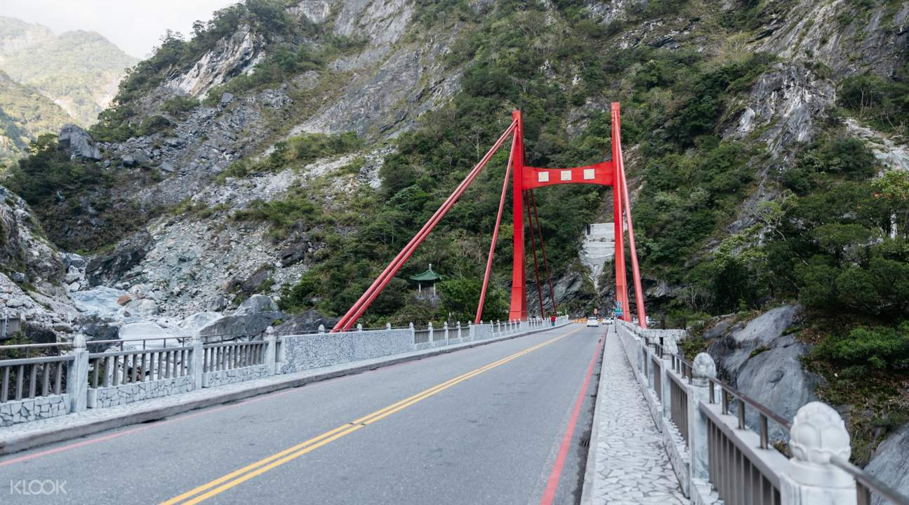 cihmu bridge with mountain in background