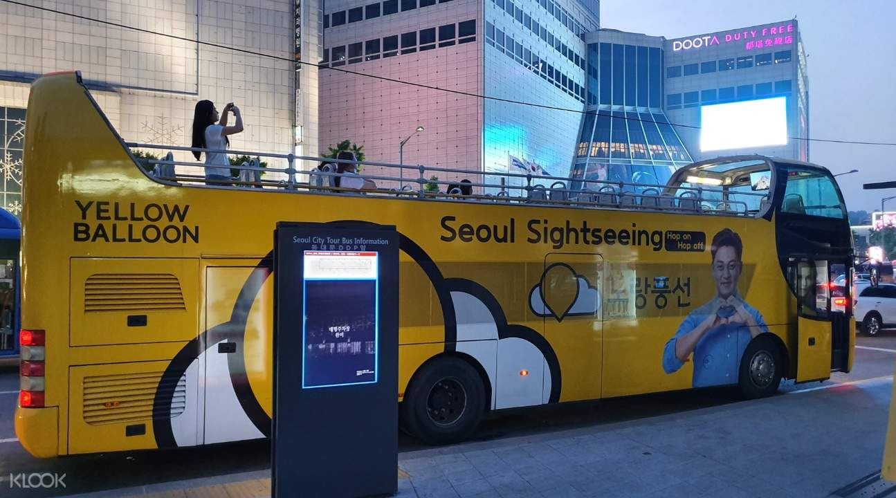 picture of double decker bus in seoul, on traditional culture course