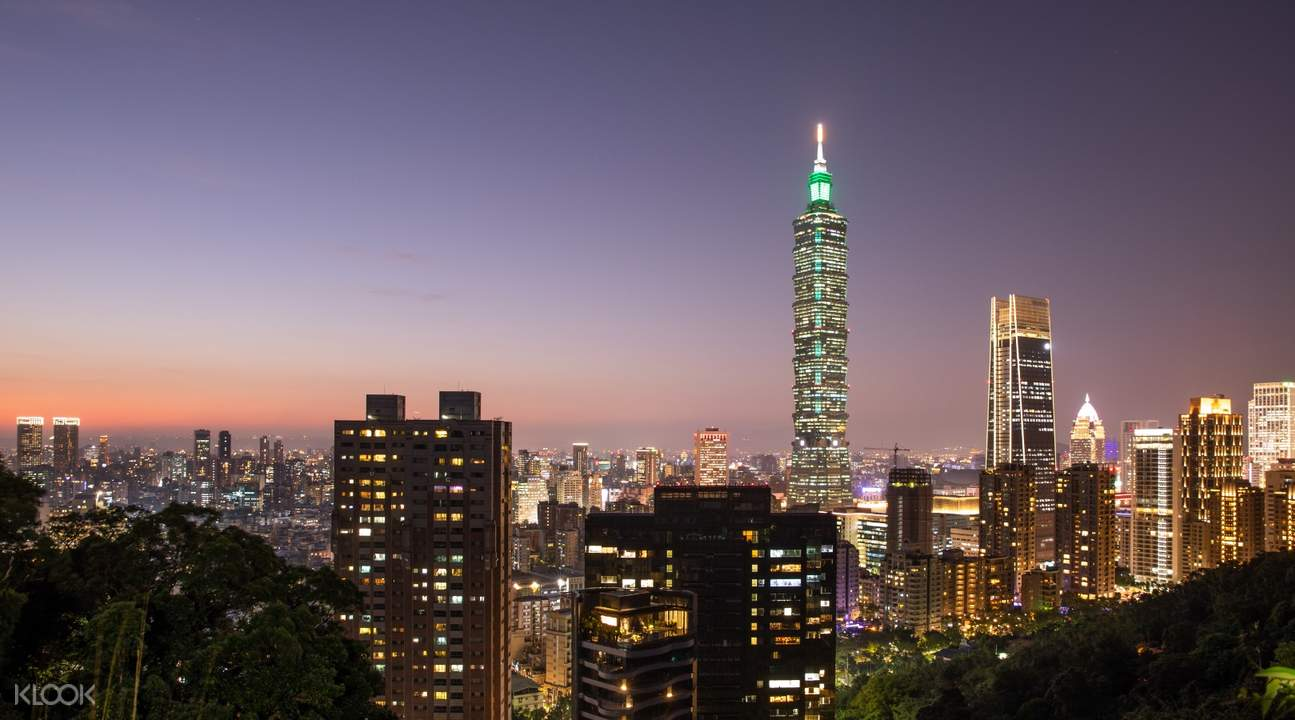 taipei 101 with other buildings in taipei at sunset