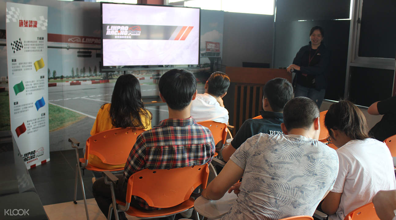 people listening to instructions at lihpao racing park