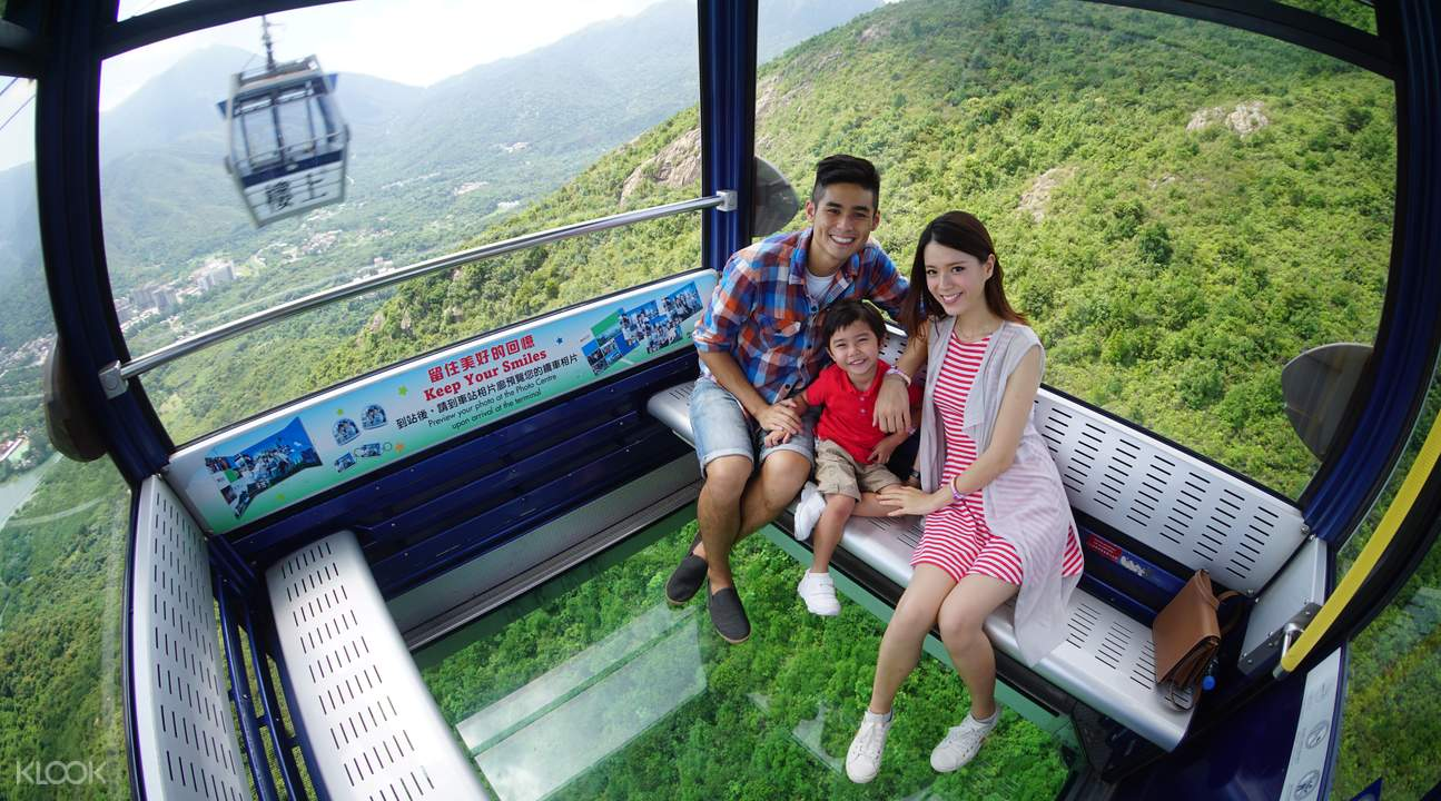 family riding crystal cable car