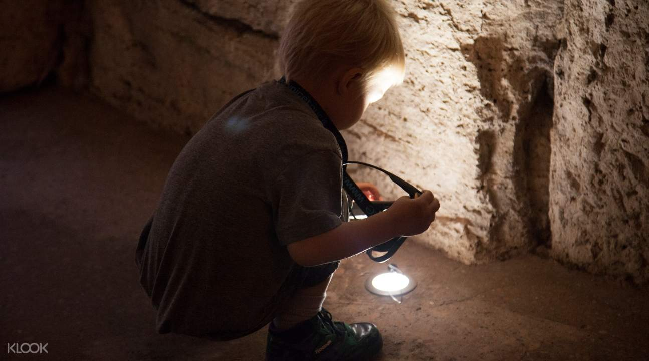 a kid participating in an interactive activity during the interactive tour