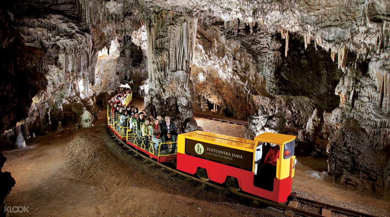 train going through Postojna Cave
