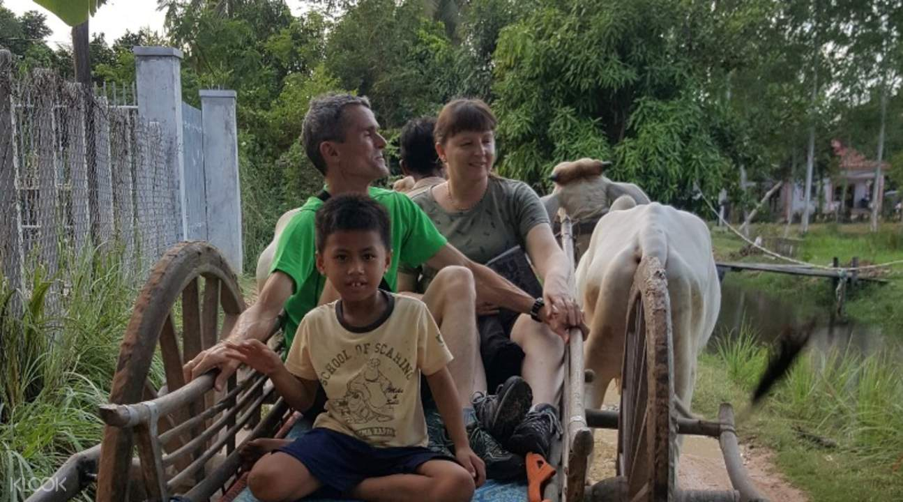 Tourists ride an animal driven cart