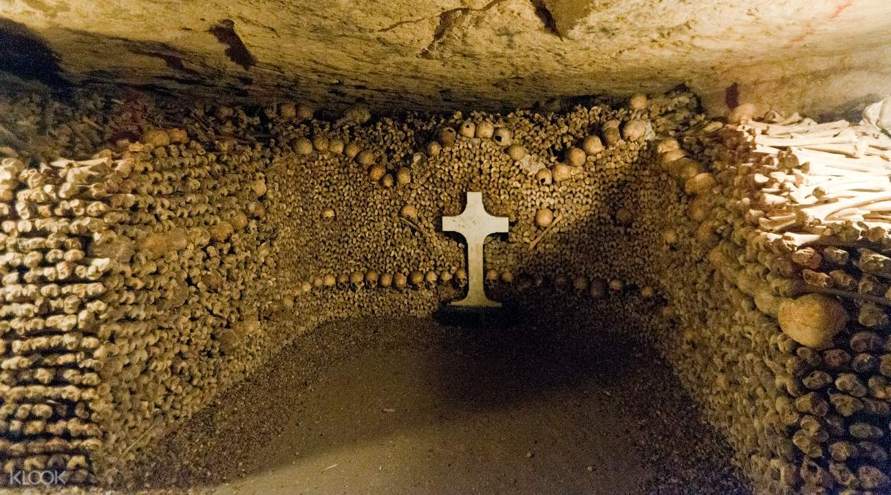 a cross in an alcove somewhere in the Catacombs; there's a cross in the middle of it