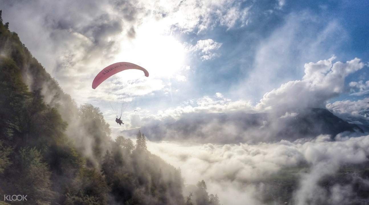 paragliding tandem through clouds