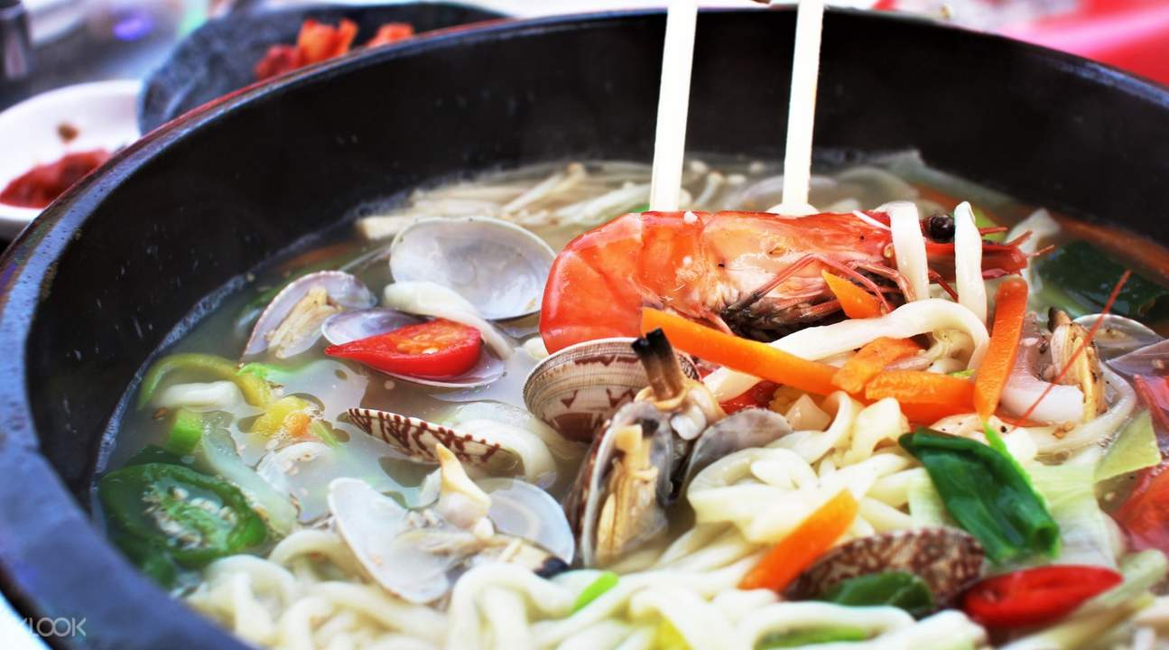a bowl of seafood noodles