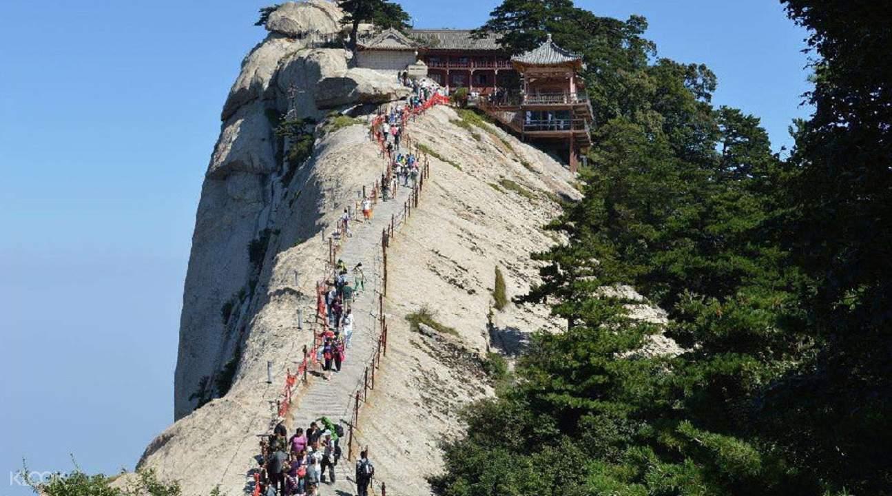 people walking up mount hua