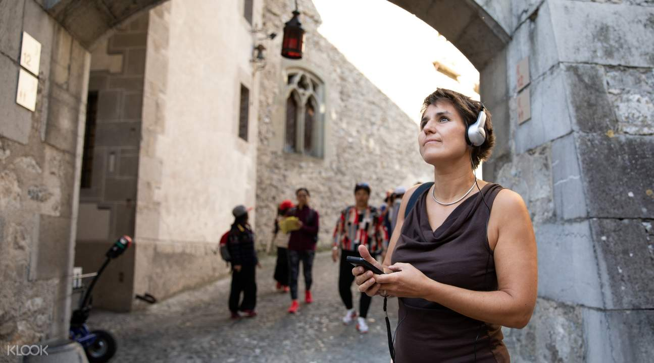 woman wearing headphones in Château de Chillon